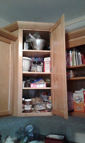 Kitchen cabinet before organizing