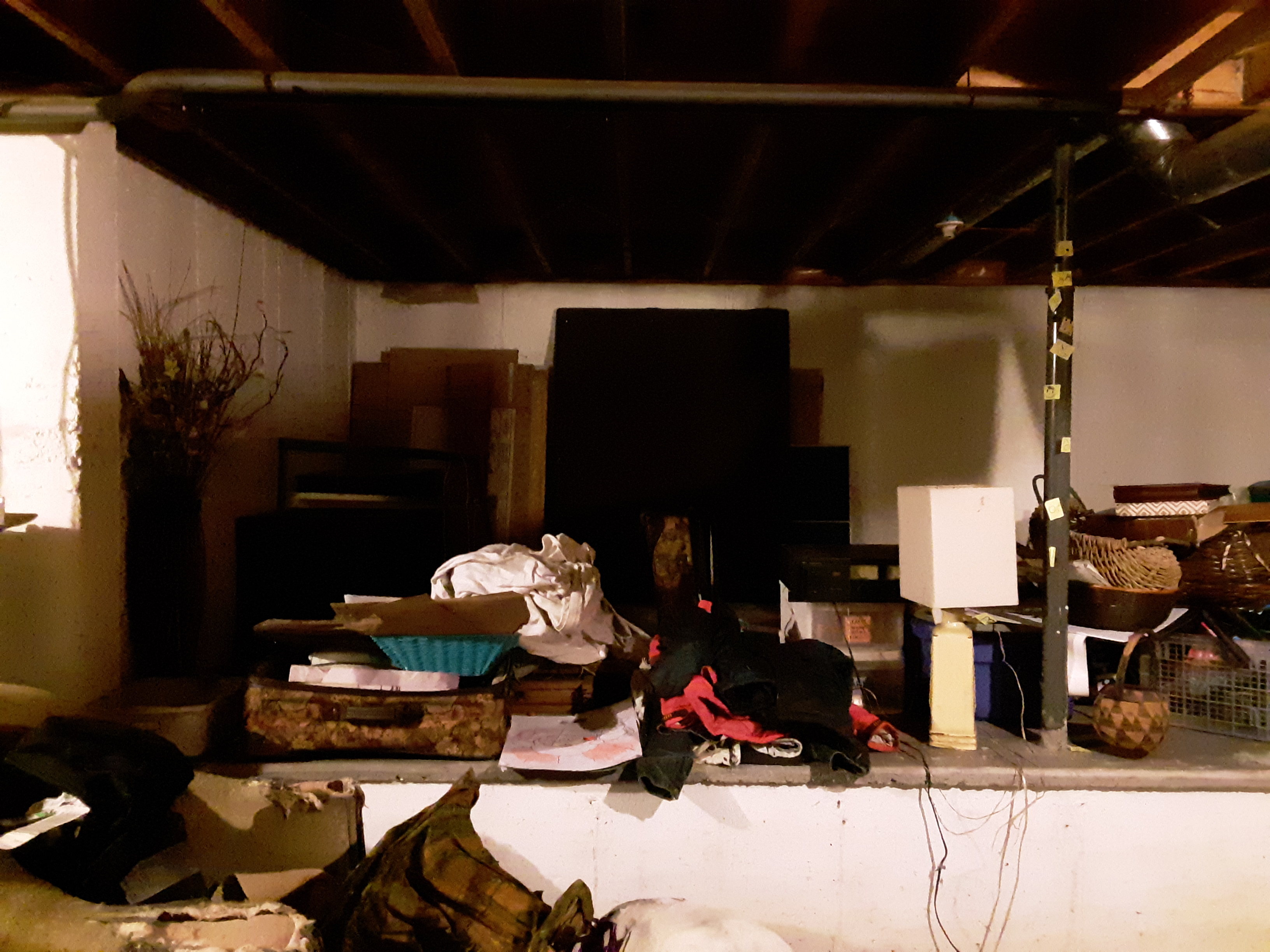 Part of the basement before we cleared its clutter!