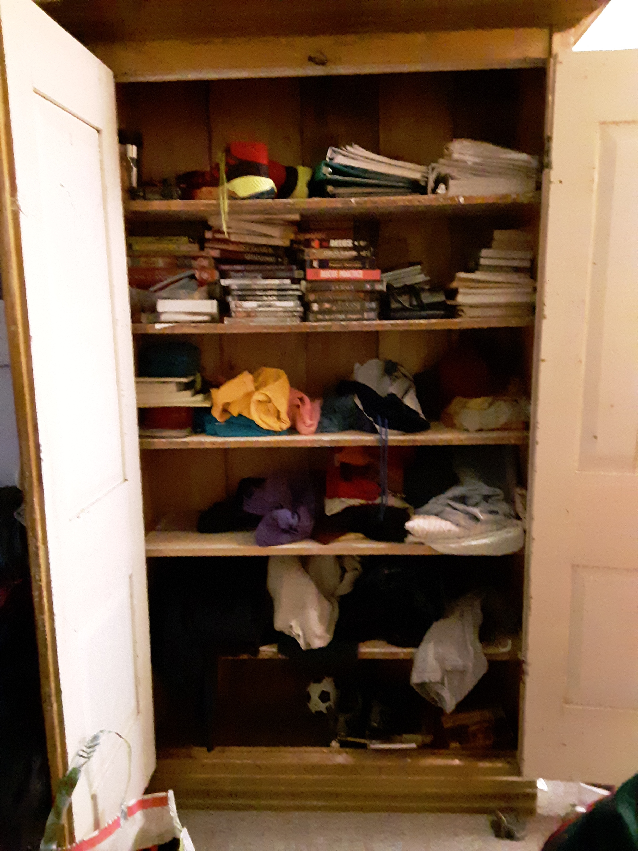 A tall armoire before we organized it