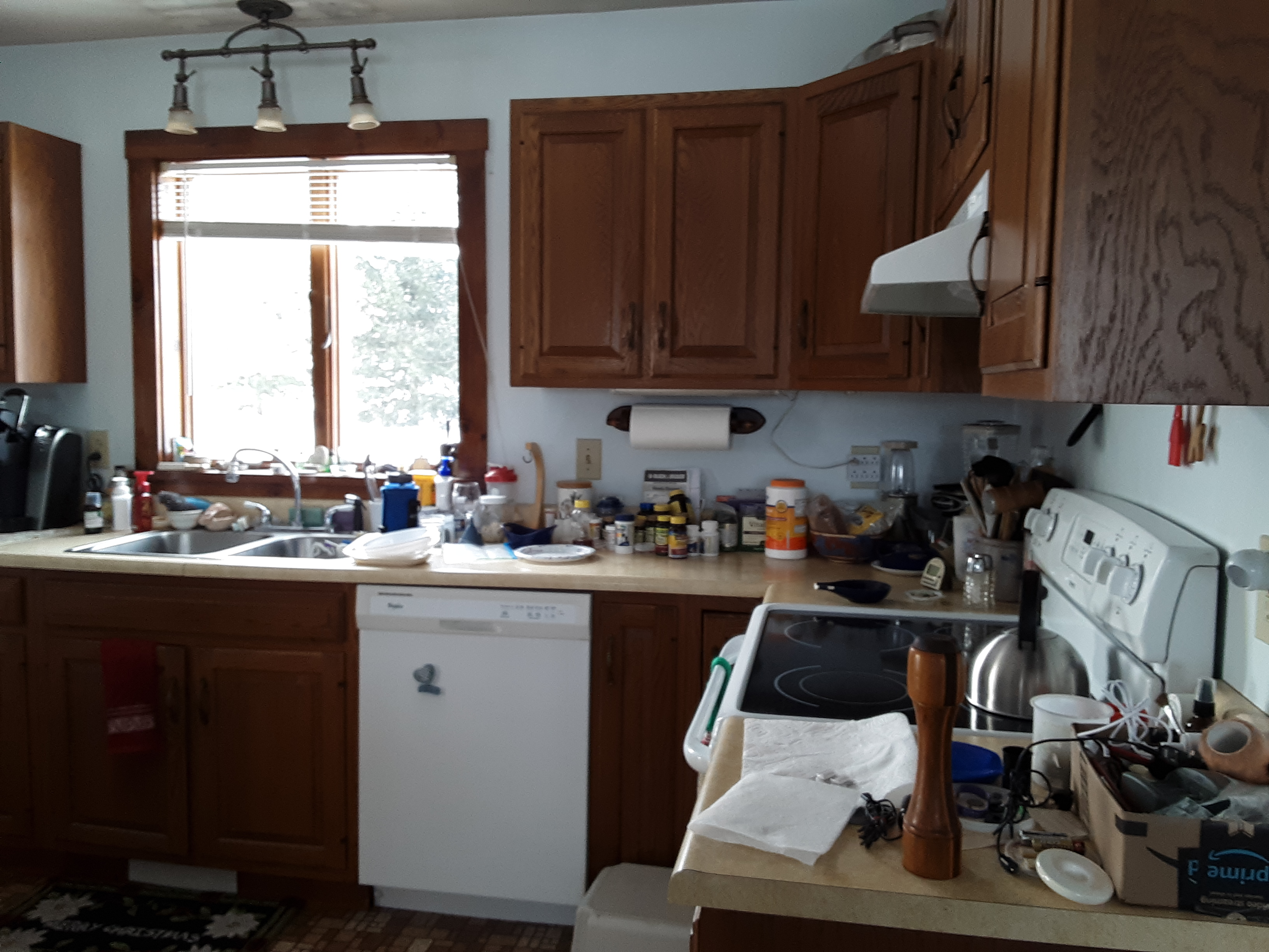 Part of the kitchen counter before we cleared its clutter