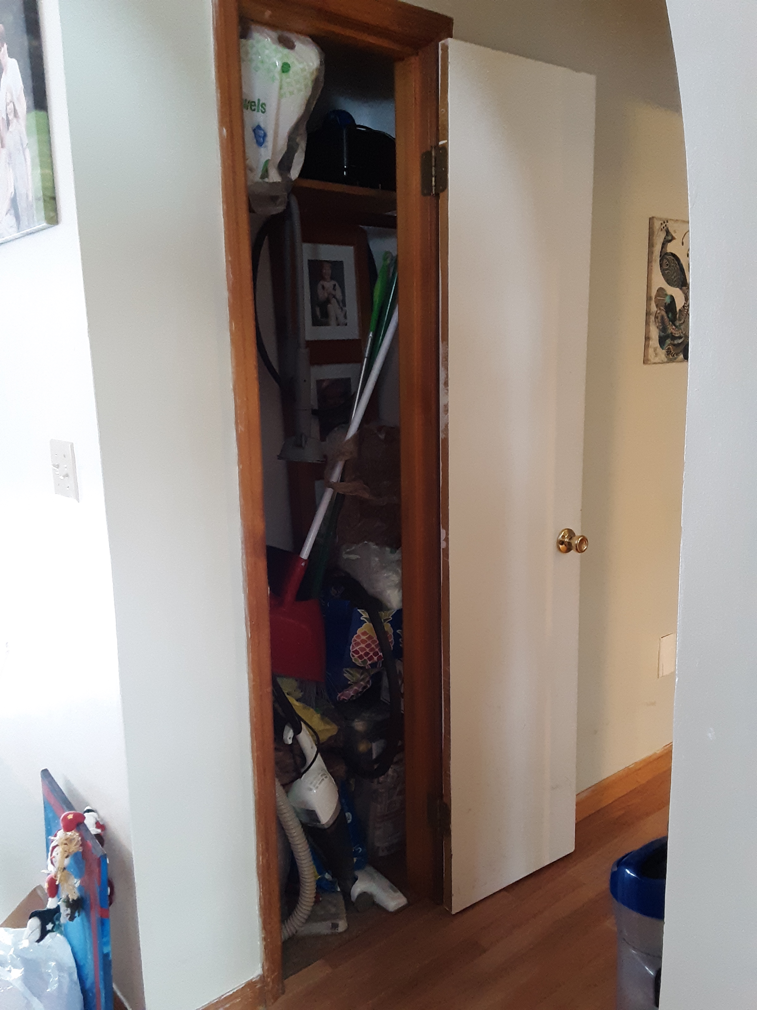 A hallway closet before we cleared its clutter