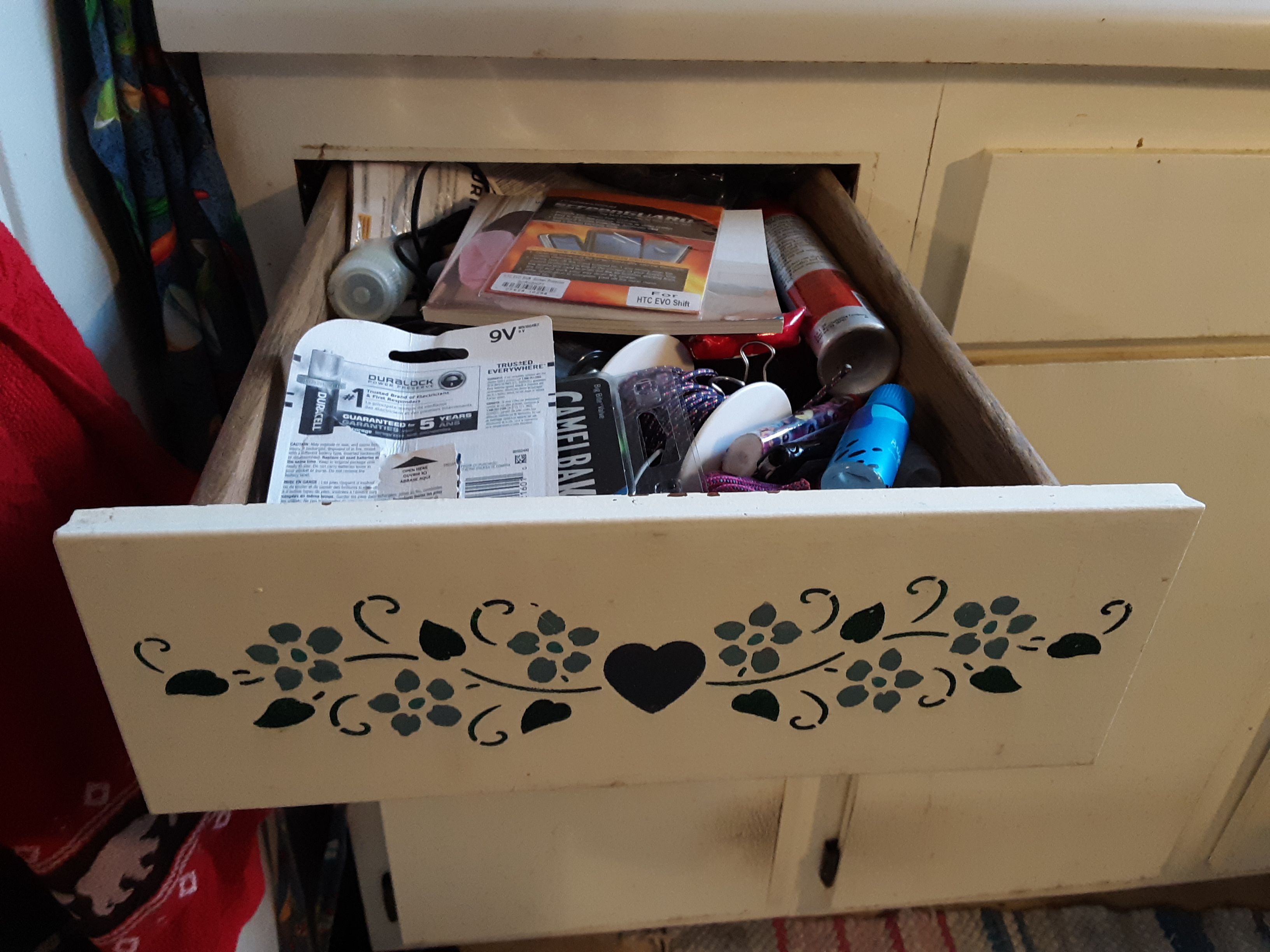 The very full junk drawer before organizing