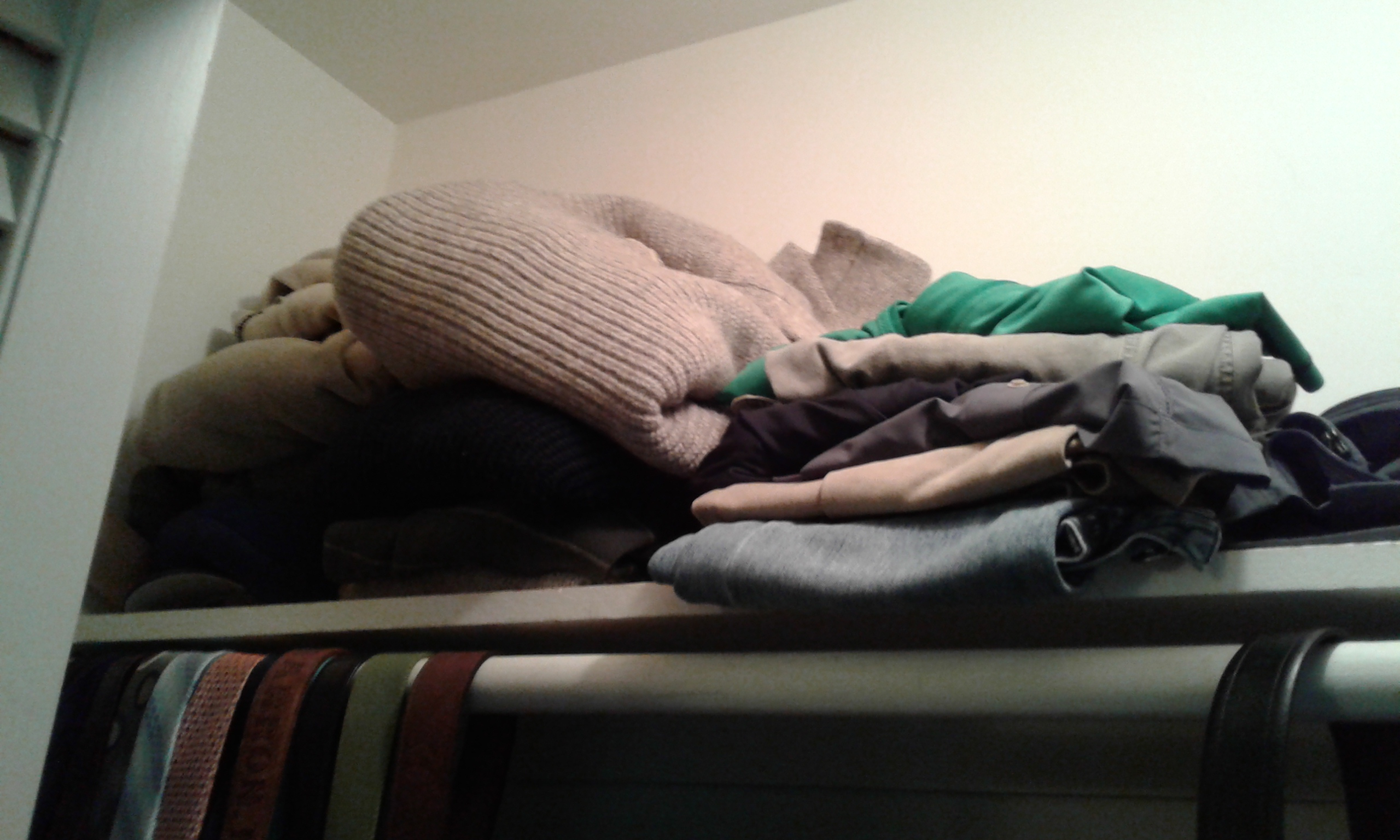 A closet shelf before we cleared its clutter and reorganized it