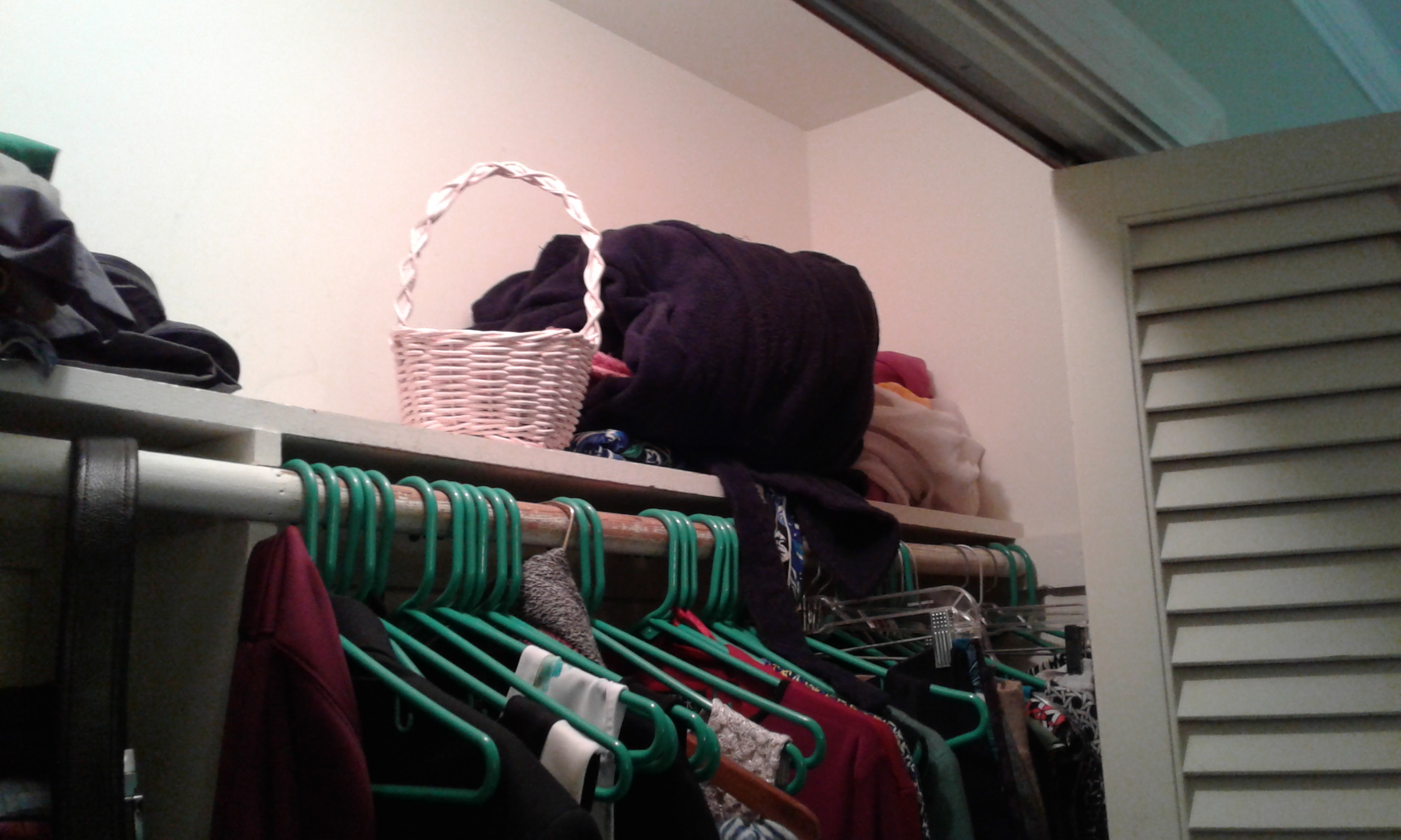 A closet shelf, before we cleared its clutter
