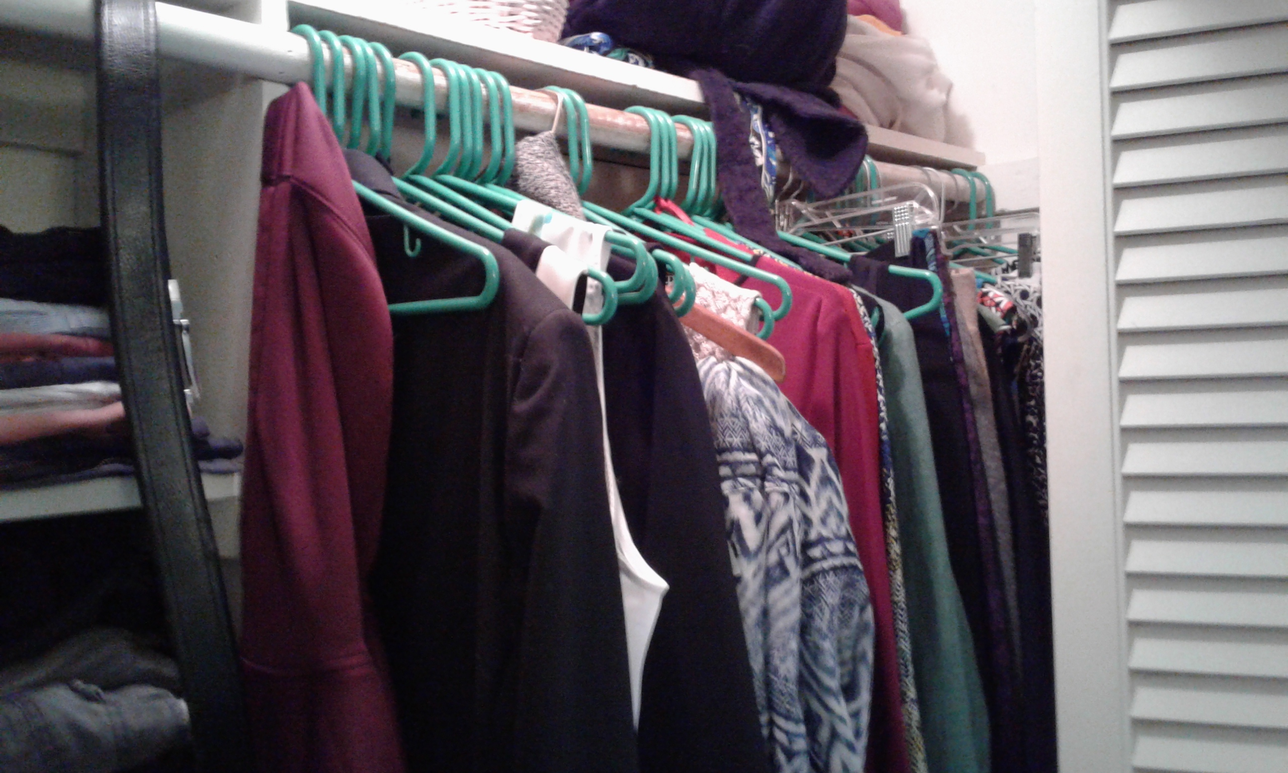 Etienne's hanging clothes before we rearranged them