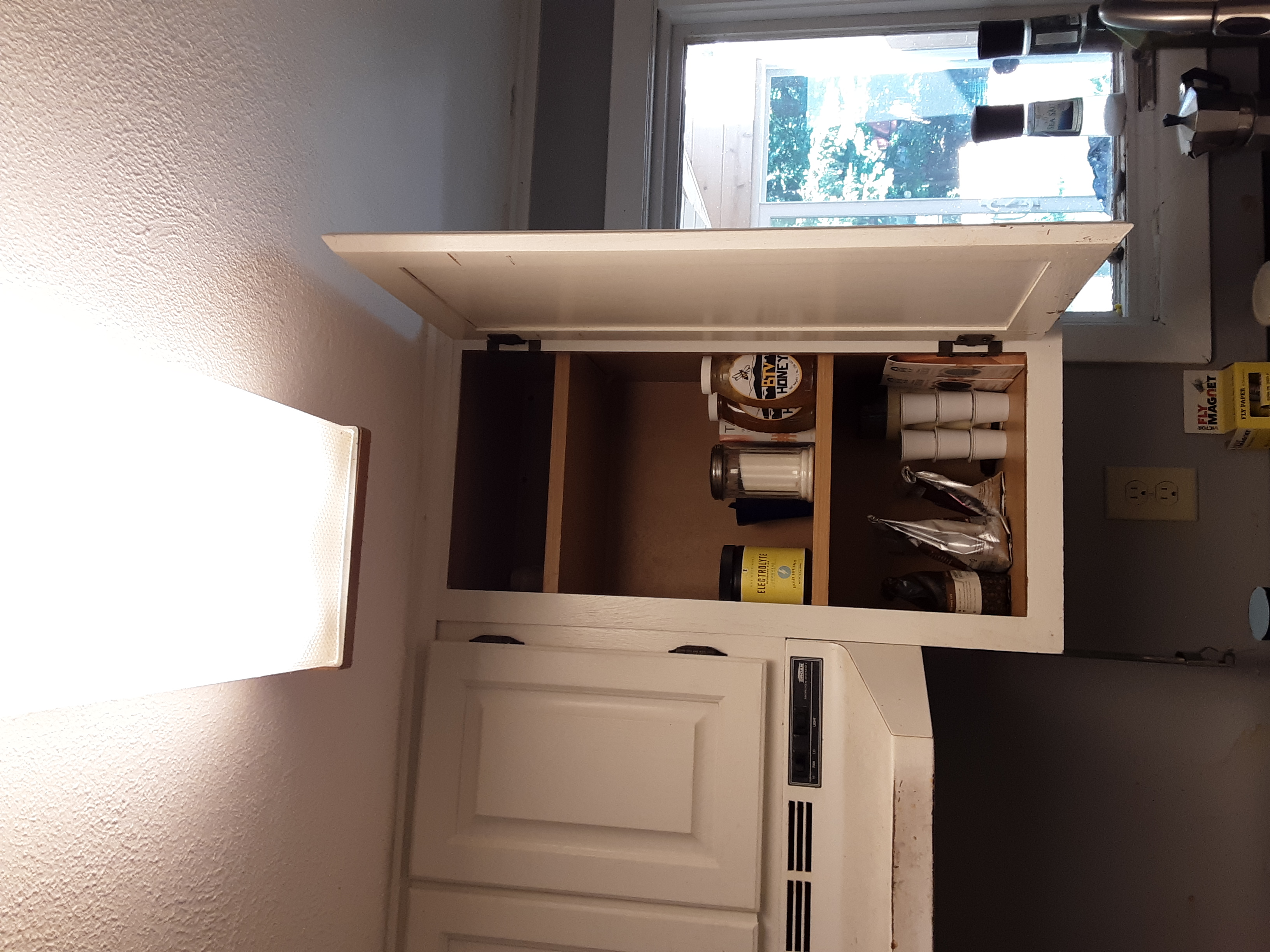 A cleared cupboard with a free shelf!