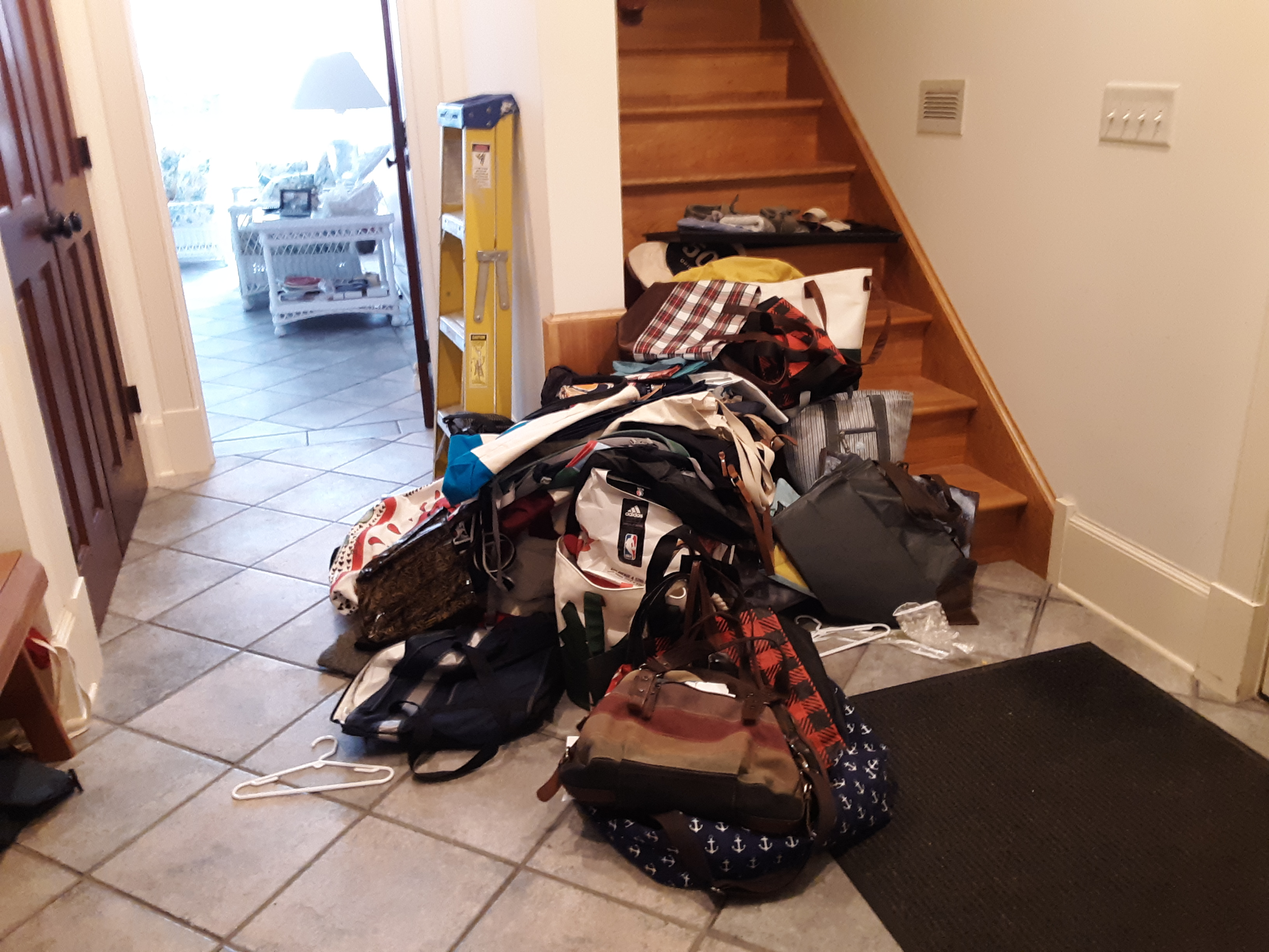 The hallway floor, with items from the closet