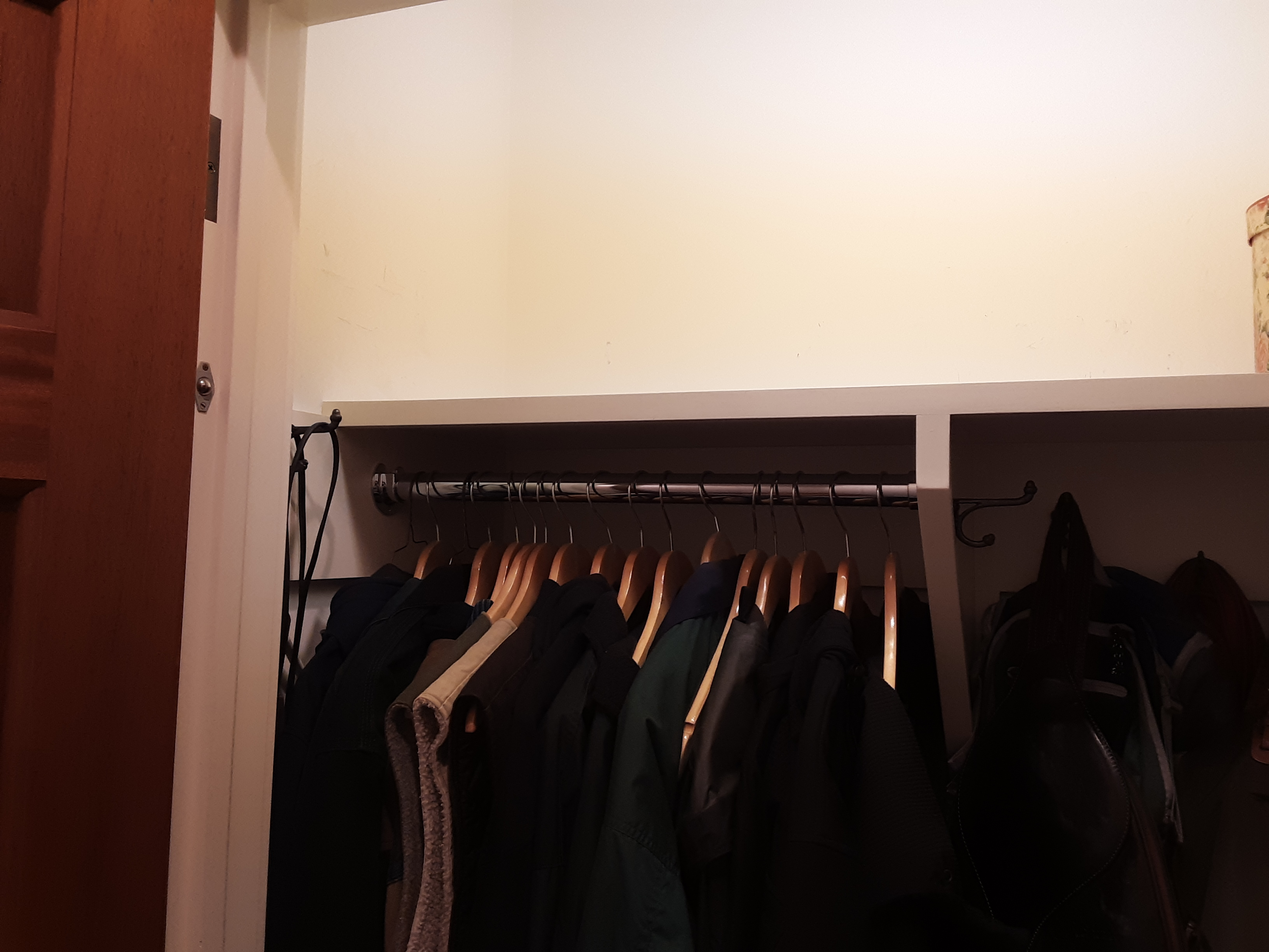 Closet shelf clutter cleared with empty space available!