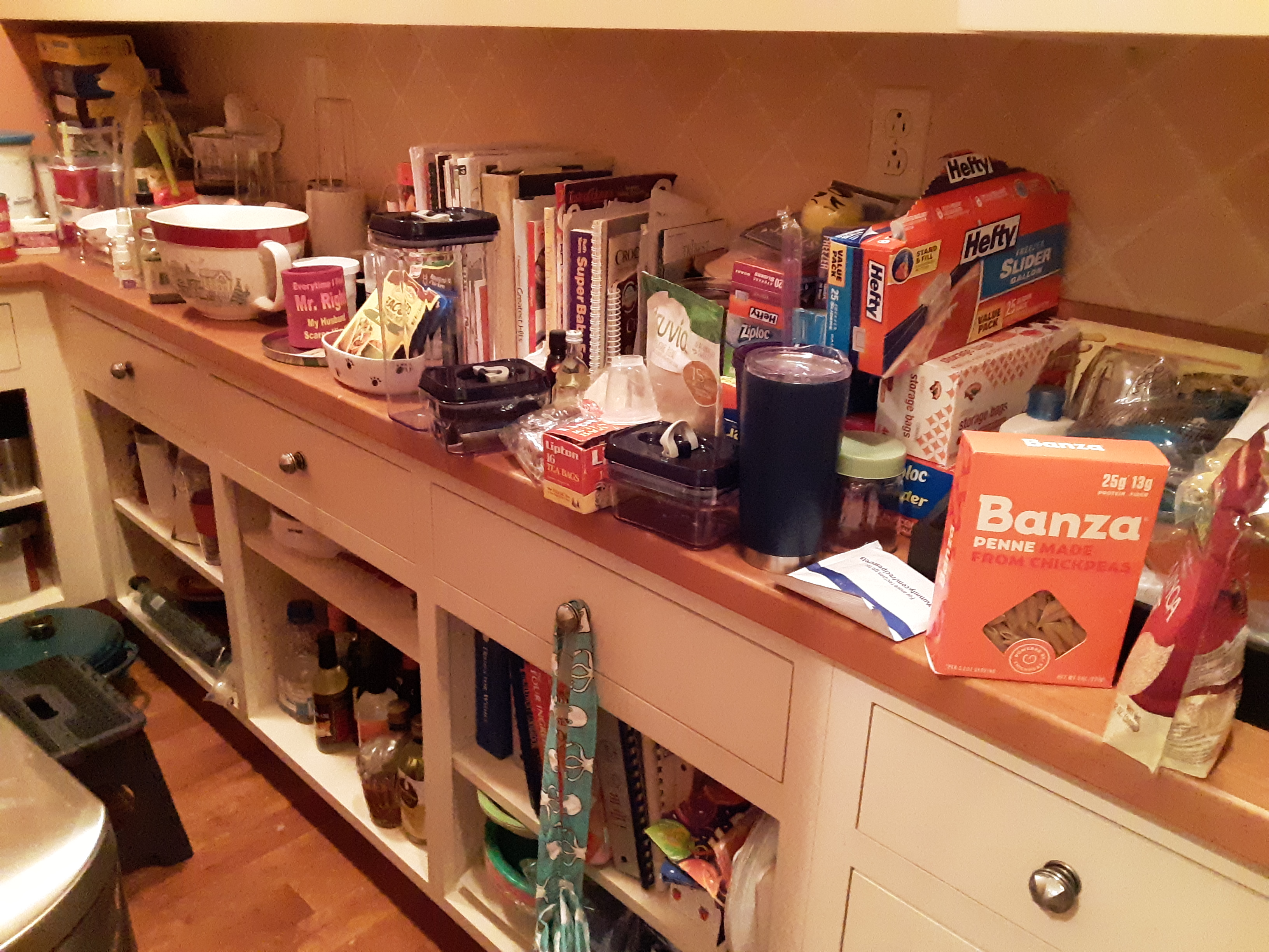 The crowded  and cluttered pantry counter