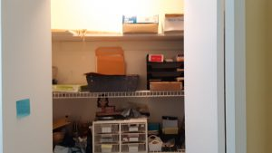 Office closet shelves before we cleared them