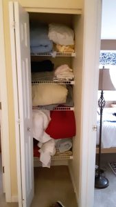 """A cluttered linen closet before we cleared it"