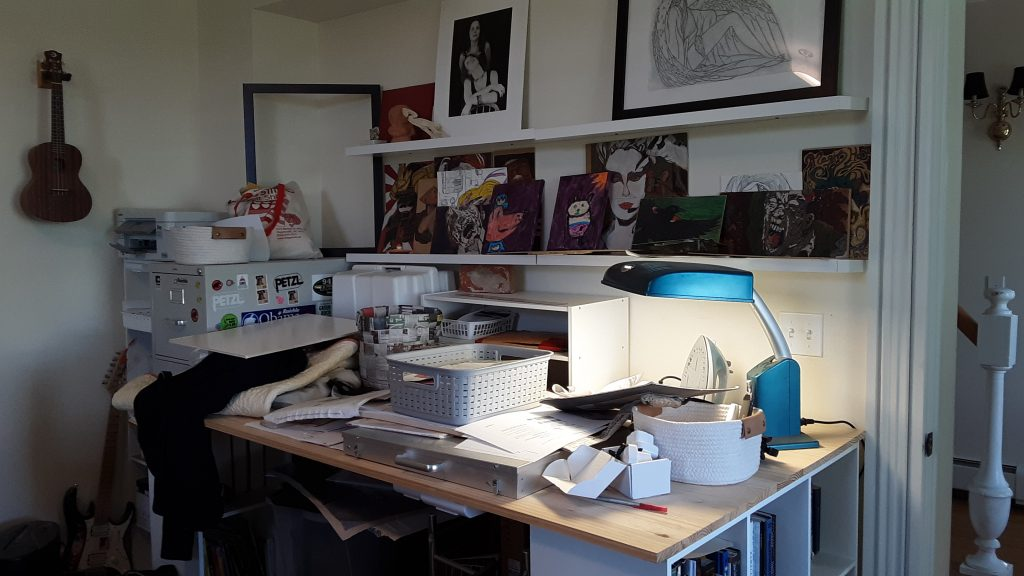 The cluttered sewing table, without room for even a needlle!