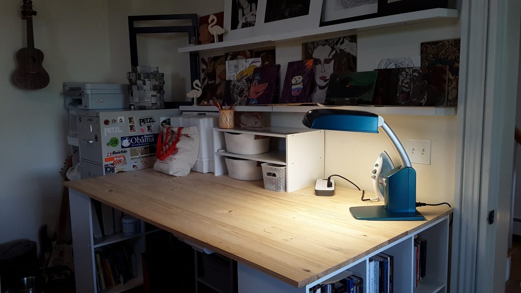 The sewing table's side view. after we cleared its clutter