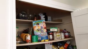 Two pantry shelves before we re-arranged them.