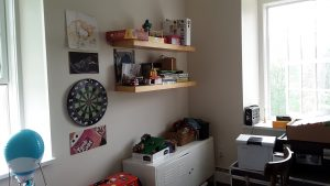 Cluttered shelves and small cabinet before we cleared them