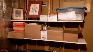 Organized shelves, including an art piece and old family photo