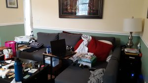 The cluttered couch, now a work space