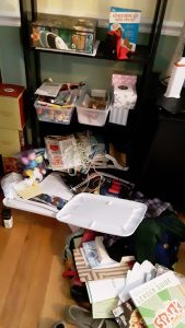 Crafts and other papers spilled onto the floor