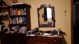 The dresser before we cleared its clutter
