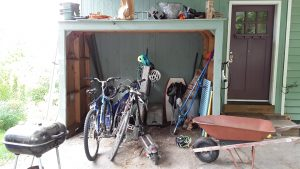 The cluttered mini garage