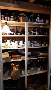 Cluttered shelves before we cleared them