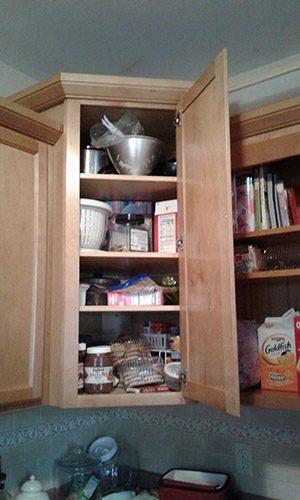 Kitchen cabinet before organizing