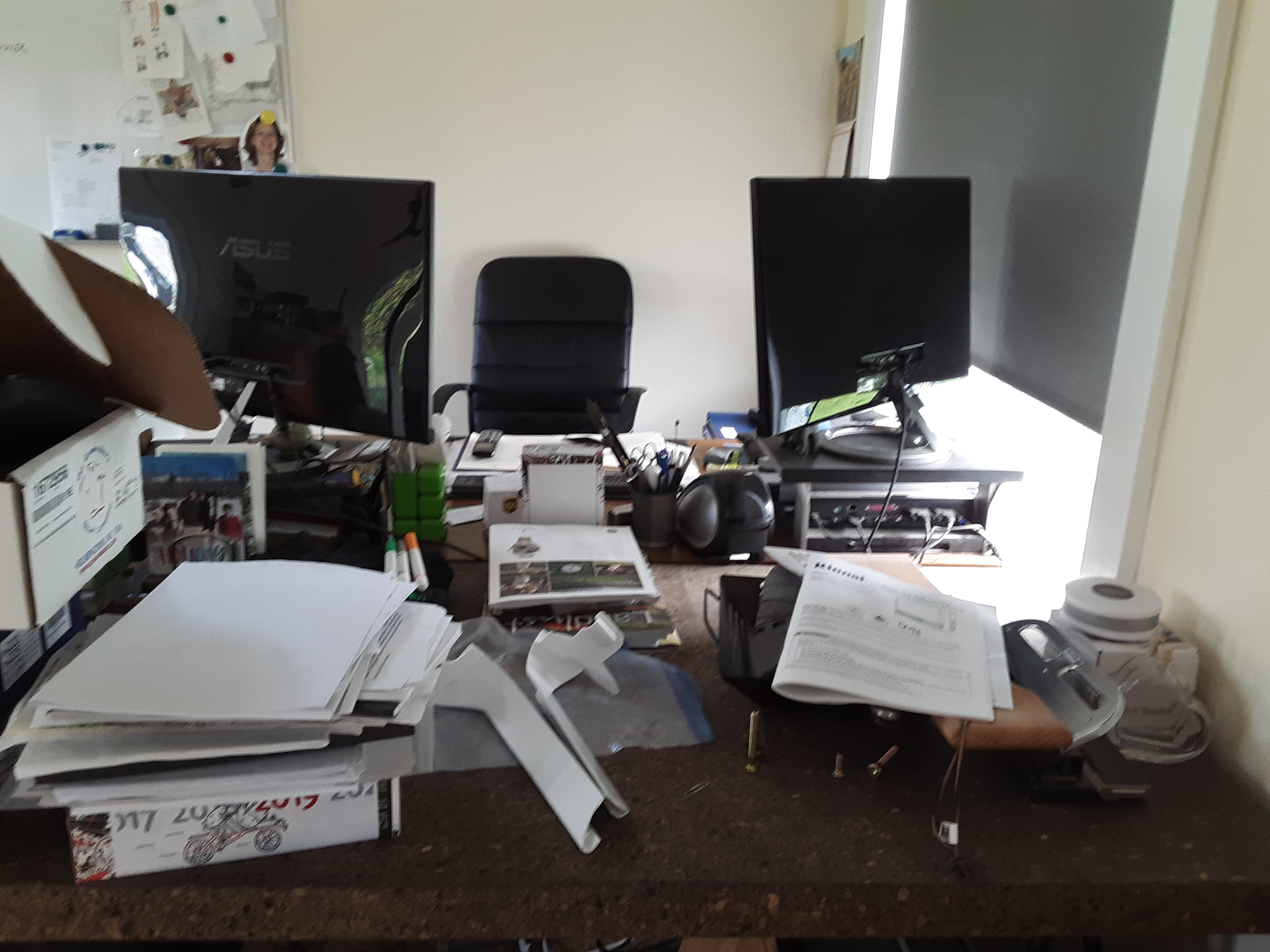 Two desks before we cleared their clutter