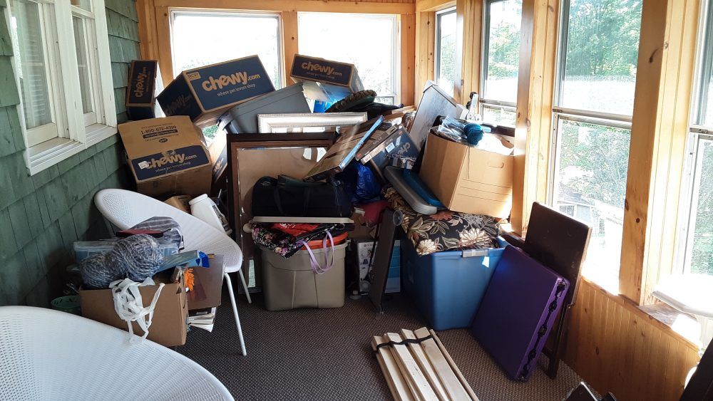 A cluttered porch area